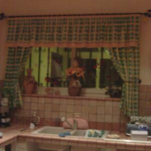 Tenda con bastone in ferro battuto e mantovana
